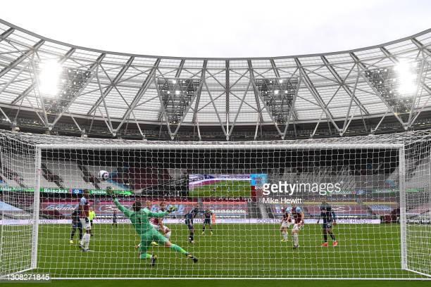 Lukasz Fabianski of West Ham United looks on as Tomas Soucek of West Ham United scores an own goal during the Premier League match between West Ham...