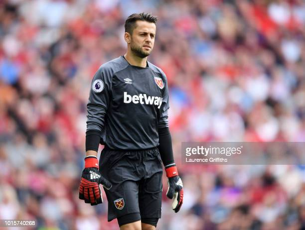 Lukasz Fabianski of West Ham United looks on during the Premier League match between Liverpool FC and West Ham United at Anfield on August 12 2018 in...
