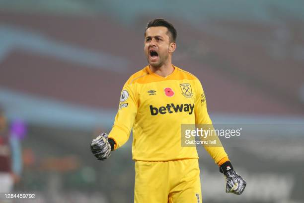Lukasz Fabianski of West Ham United reacts after saving a penalty from Ademola Lookman of Fulham during the Premier League match between West Ham...