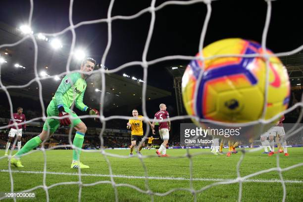 Lukasz Fabianski of West Ham United reacts as he concedes Wolverhampton Wanderers first goal during the Premier League match between Wolverhampton...