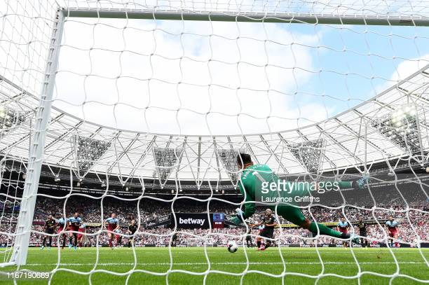 Lukasz Fabianski of West Ham United saves a penalty from Sergio Aguero of Manchester City which is then retaken due to him coming off his line during...