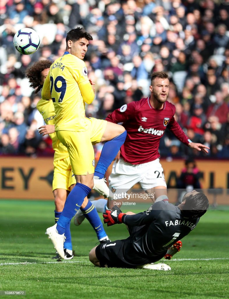 Lukasz Fabianski of West Ham United saves a shot from Alvaro Morata of Chelsea during the Premier League match between West Ham United and Chelsea FC at London Stadium on September 23, 2018 in London, United Kingdom.