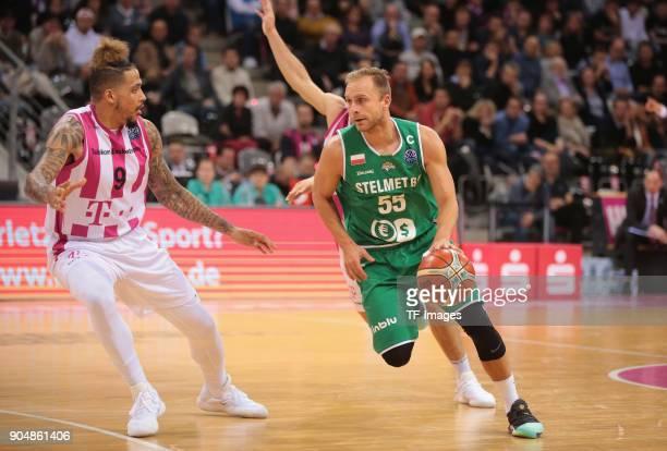 Lukasz Koszarek of Zielona Gora and Julian Gamble of Bonn battle for the ball during the Basketball Champions League match between Telekom Baskets...