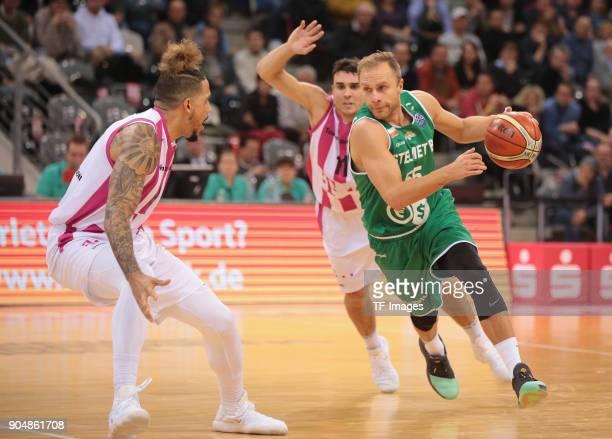 Lukasz Koszarek of Zielona Gora Julian Gamble of Bonn and Anthony DiLeo battle for the ball during the Basketball Champions League match between...