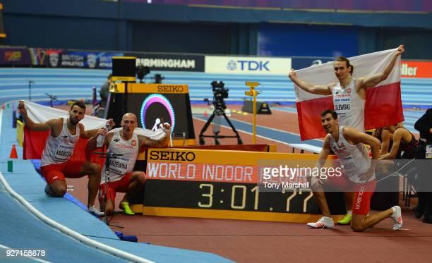 Lukasz Krawczuk Jakub Krzewina Rafal Omleko and Karol Zalewski of Poland celebrate winning the Men's 4 x 400m Relay Final and setting a new World...