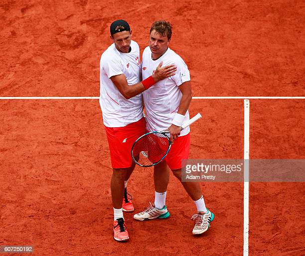 Lukasz Kubot and Marcin Matkowski of Poland celebrate victory in their match against Daniel Brand and Daniel Masur of Germany during the 3rd rubber...