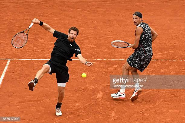 Lukasz Kubot of Poland and Alexander Peya of Austria in action during the Men's Doubles semi final match against Mike Bryan and Bob Bryan of the...