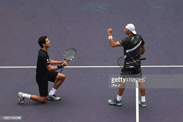 Lukasz Kubot of Poland and Marcelo Melo of Brazil celebrate after defeating Jamie Murray of Great Britain and Bruno Soares of Brazil during the final...