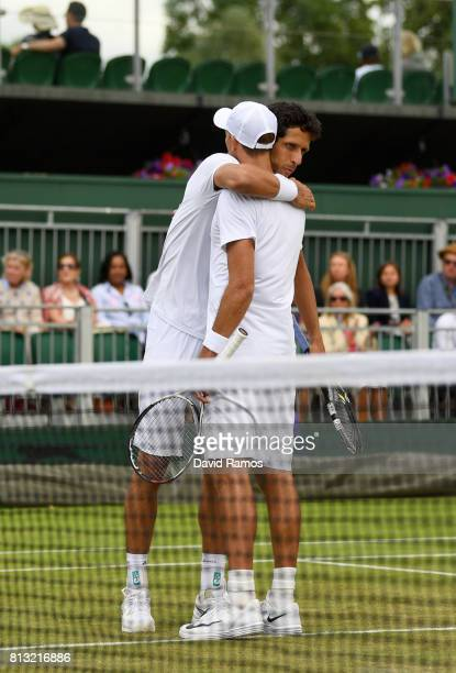 Lukasz Kubot of Poland and Marcelo Melo of Brazil celebrate after the Gentlemen's Doubles quarter final match against Ken Skupski of Great Britain...