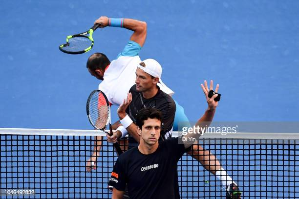Lukasz Kubot of Poland and Marcelo Melo of Brazil celebrates after win while opponent thow his tennis rackets on the field during their Men's Doubles...