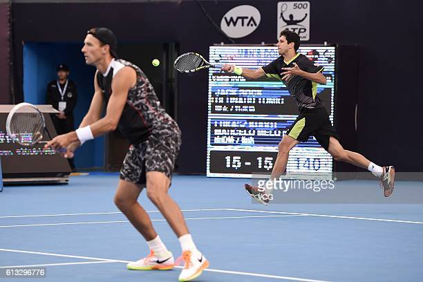 Lukasz Kubot of Poland and Marcelo Melo of Brazil compete against Jack Sock of the United States and Bernard Tomic of Australia during the Men's...