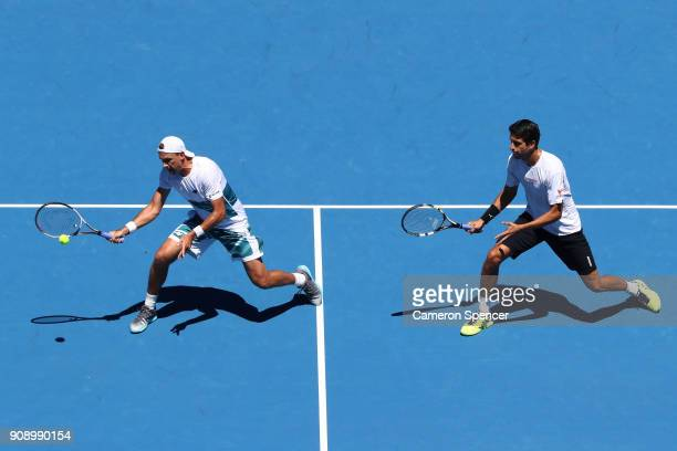 Lukasz Kubot of Poland and Marcelo Melo of Brazil compete in their fourth round men's doubles final against Ben McLachlan of Japan and JanLennard...