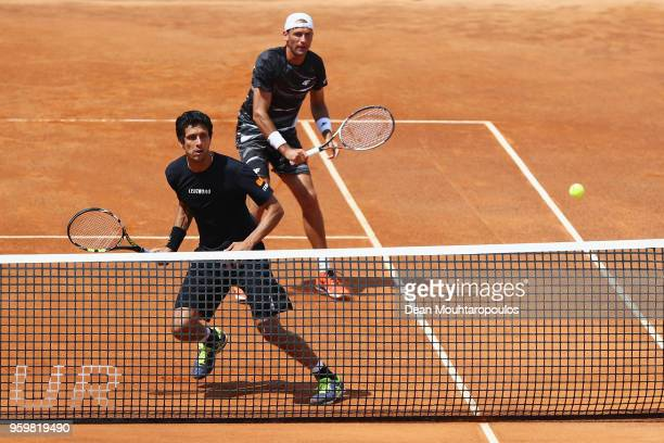 Lukasz Kubot of Poland and Marcelo Melo of Brazil compete in their quarter final doubles match against Juan Sebastian Cabal and Robert Farah both of...