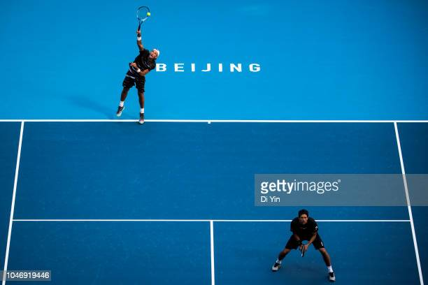Lukasz Kubot of Poland and Marcelo Melo of Brazil returns the ball against Oliver Marach of Austria and Mate Pavic of Croatia during their Men's...