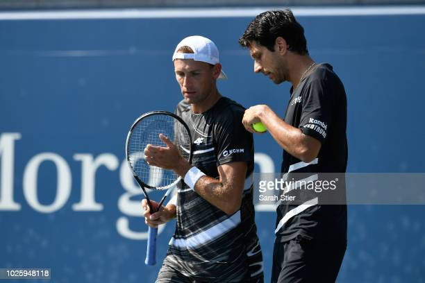 Lukasz Kubot of Poland and Marcelo Melo of Brazil talk during their men's doubles second round match on Day Six of the 2018 US Open at the USTA...