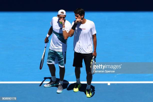 Lukasz Kubot of Poland and Marcelo Melo of Brazil talk tactics in their fourth round men's doubles final against Ben McLachlan of Japan and...