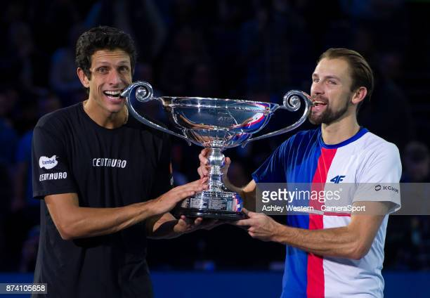 Lukasz Kubot of Poland and Marcelo Melo of Brazil with the ATP World Tour trophy after being ranked World Number One at O2 Arena on November 13 2017...