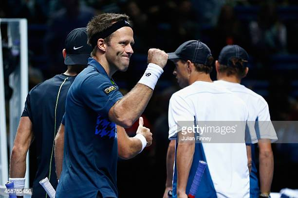 Lukasz Kubot of Poland and Robert Lindstedt of Sweden celebrate their win over Bob and Mike Bryan of USA in the round robin doubles during day two of...