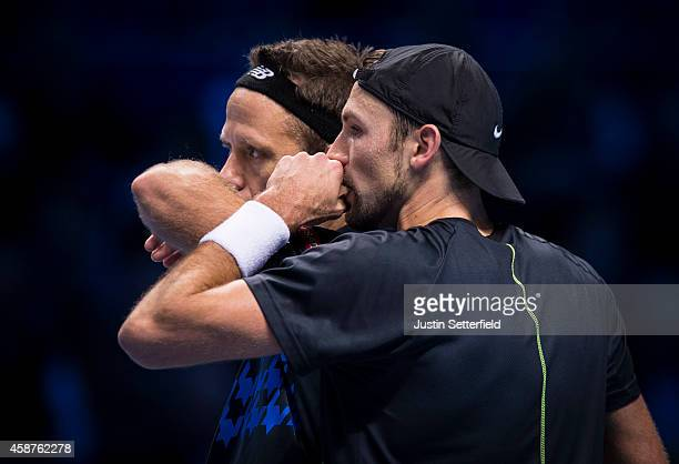Lukasz Kubot of Poland and Robert Lindstedt of Sweden talk tactics in their match against Bob and Mike Bryan of USA in the round robin doubles during...