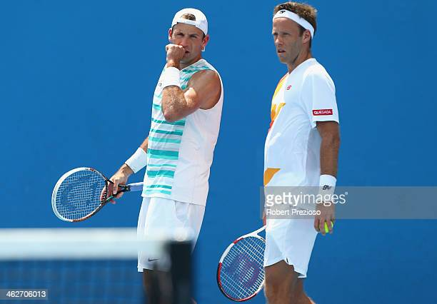 Lukasz Kubot of Poland and Robert Lindstedt of Sweden talk tactics in their first round doubles match against Federico Delbonis of Argentina and...