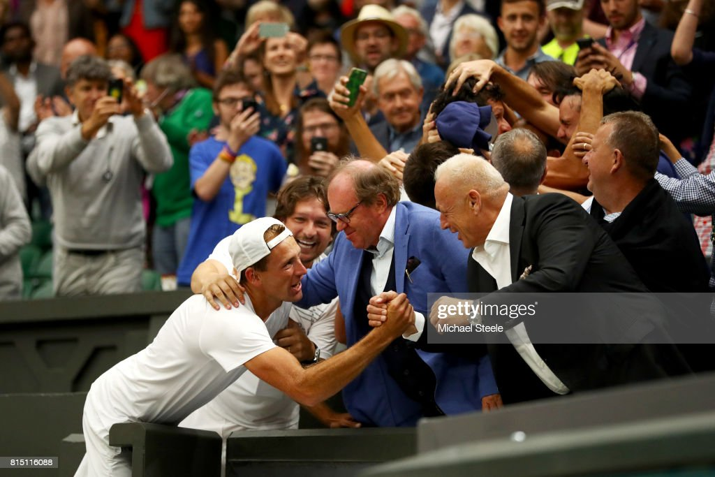 Lukasz Kubot of Poland celebrate victory in the stands during the Gentlemen's Doubles final against Oliver Marach of Austria and Mate Pavic of Croatia on day twelve of the Wimbledon Lawn Tennis Championships at the All England Lawn Tennis and Croquet Club at Wimbledon on July 15, 2017 in London, England.