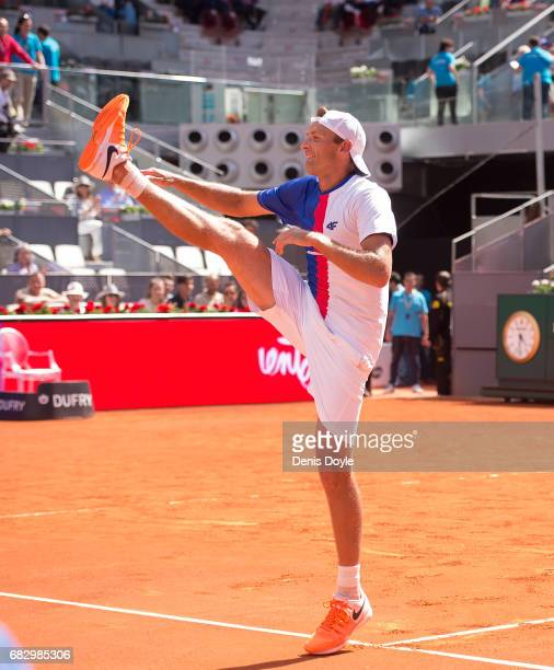 Lukasz Kubot of Poland celebrates after beating with teammate Marcelo Melo of Brazil Nicolas Mahut and Edouard RogerVasselin of France in the men's...