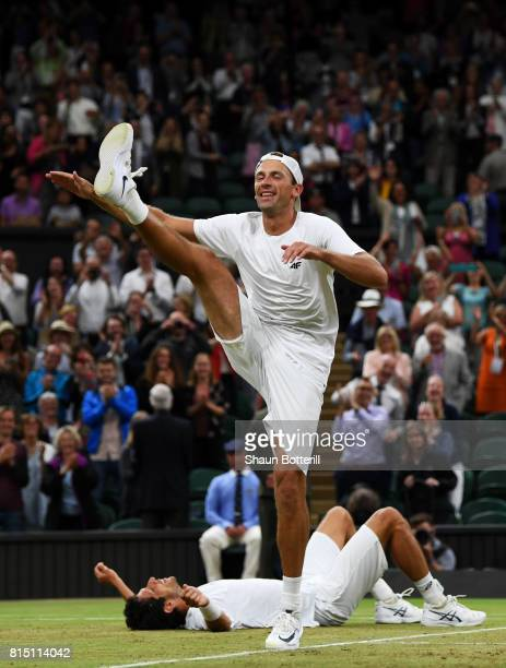 LONDON ENGLAND JULY 15 Lukasz Kubot of Poland dances in celebration as Marcelo Melo of Brazil looks on after victory in the Gentlemen's Doubles final...