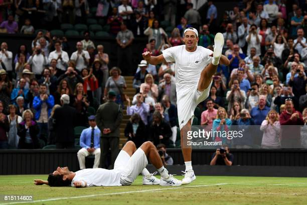 Lukasz Kubot of Poland dances in celebration as Marcelo Melo of Brazil looks on after victory in the Gentlemen's Doubles final against Oliver Marach...
