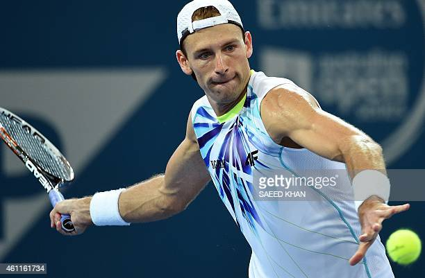 Lukasz Kubot of Poland hits a return against Sam Groth of Australia during their men's singles second round match at the Brisbane International...