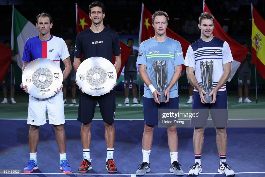 Lukasz Kubot of Poland, Marcelo Melo of Brazil, Henri Kontinen of Finland and John Peers of Australia pose with their trophy after the Men's doubles final match on day eight of 2017 ATP Shanghai Rolex Masters at on October 15, 2017 in Shanghai, China.