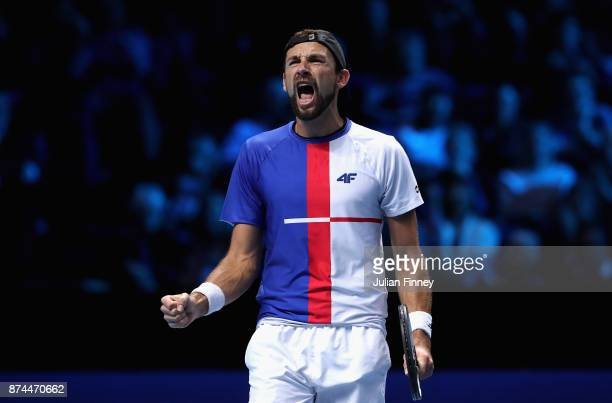 Lukasz Kubot of Poland partner of Marcelo Melo of Brazil celebrates victory during the doubles match against Mike Bryan of The United States and Bob...