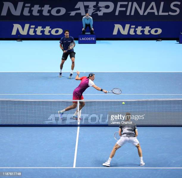 Lukasz Kubot of Poland, playing partner of Marcelo Melo volleys during their doubles match against Rajeev Ram of The United States and Joe Salisbury...