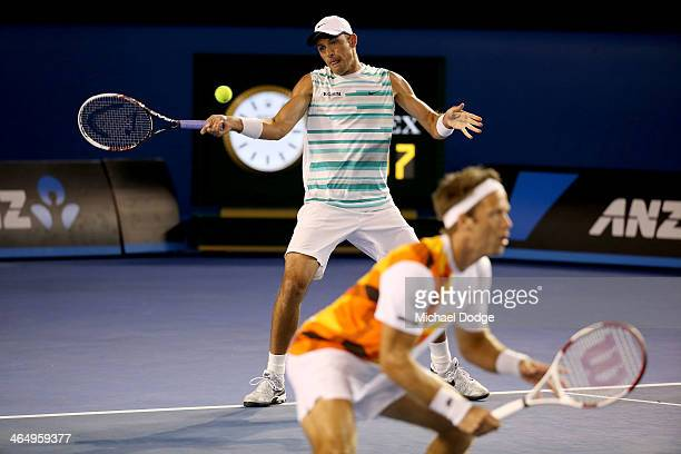 Lukasz Kubot of Poland plays a forehand in his Men's Doubles Final with Robert Lindstedt of Sweden against Eric Butorac of the United States and...
