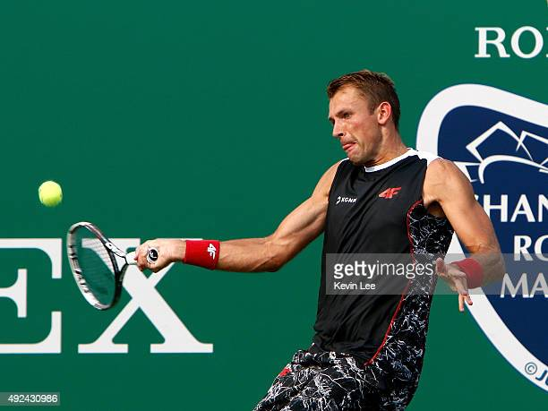 Lukasz Kubot of Poland returns a shot to Jack Sock of United States during his match on day 3 of Shanghai Rolex Masters 2015 at Qi Zhong Tennis...