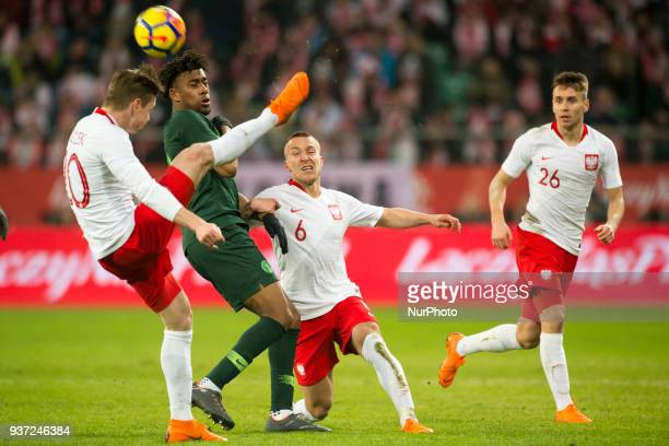 Lukasz Piszczek and Jacek Goralski of Poland battle for the ball with Alex Iwobi of Nigeria during the international friendly match between Poland...