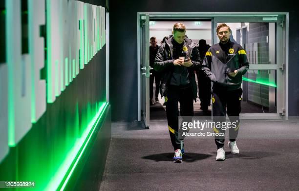 Lukasz Piszczek and Marcel Schmelzer of Borussia Dortmund arrive at the stadium prior to the Bundesliga match between Borussia Moenchengladbach and...