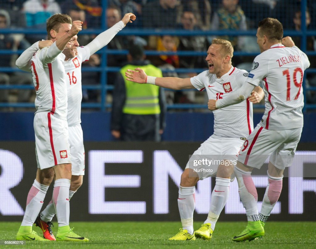 Lukasz Piszczek, Jakub Blaczczykowski, Kamil Glik and Piotr Zielinski of Poland celebrate after goal for Poland during the FIFA World Cup 2018 Qualifying Round Group E match between Montenegro and Poland at Gradski Stadion in Podgorica, Montenegro on March 26, 2017