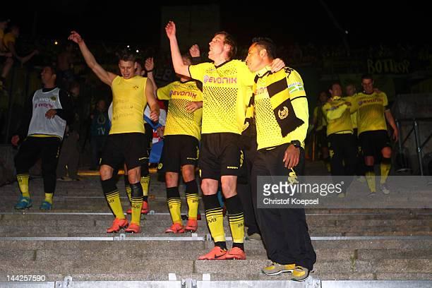 Lukasz Piszczek Kevin Grosskreutz and Antonio da Silva of Dortmund celebrate after winning the DFB Cup final match between Borussia Dortmund and FC...