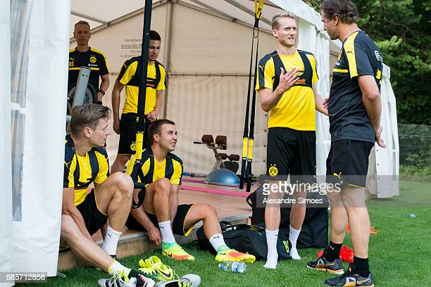 Lukasz Piszczek Mario Goetze Andre Schuerrle and sports director Michael Zorc of Borussia Dortmund during a training session on the training ground...