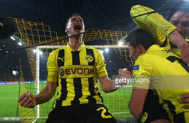 Lukasz Piszczek, Nuri Sahin and Mats Hummels of Borussia Dortmund celebrate victory in the UEFA Champions League quarter-final second leg match...