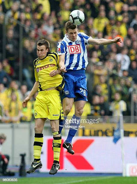 Lukasz Piszczek of Berlin and Kevin Großkreutz of Dortmund jump for a header during the Bundesliga match between Hertha BSC Berlin and Borussia...