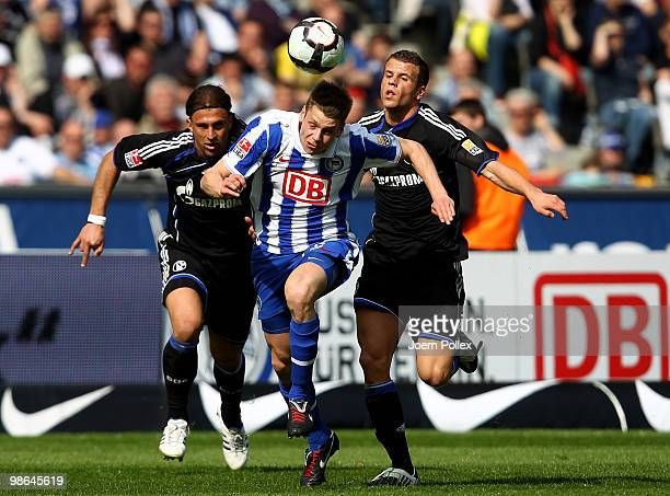 Lukasz Piszczek of Berlin and Marcelo Bordon and Lukas Schmitz of Schalke battle for the ball during the Bundesliga match between Hertha BSC Berlin...