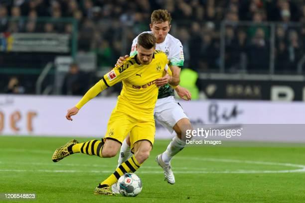 Lukasz Piszczek of Borussia Dortmund and Christoph Kramer of Borussia Moenchengladbach battle for the ball during the Bundesliga match between...
