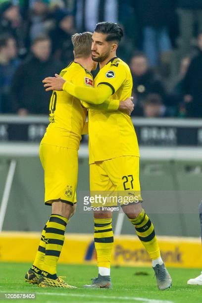 Lukasz Piszczek of Borussia Dortmund and Emre Can of Borussia Dortmund celebrate after winning the Bundesliga match between Borussia Moenchengladbach...
