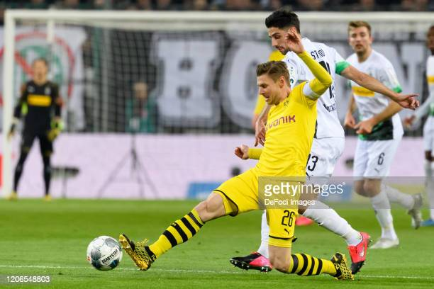 Lukasz Piszczek of Borussia Dortmund and Lars Stindl of Borussia Moenchengladbach battle for the ball during the Bundesliga match between Borussia...