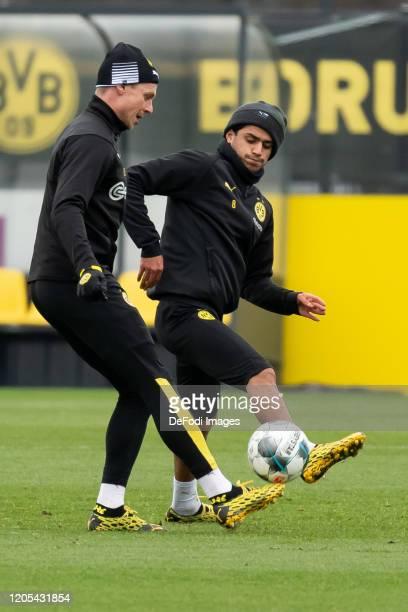 Lukasz Piszczek of Borussia Dortmund and Mahmoud Dahoud of Borussia Dortmund battle for the ball during the Borussia Dortmund Training Session on...