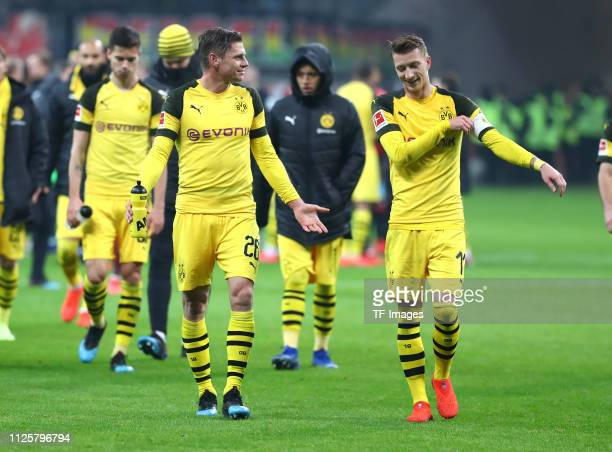 Lukasz Piszczek of Borussia Dortmund and Marco Reus of Borussia Dortmund talk to each other after the Bundesliga match between Eintracht Frankfurt...