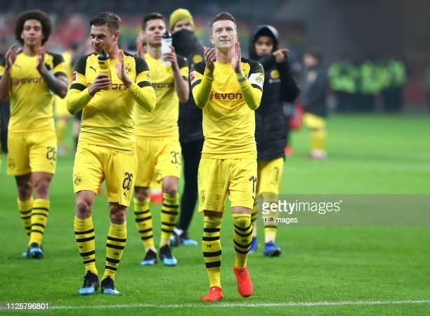 Lukasz Piszczek of Borussia Dortmund and Marco Reus of Borussia Dortmund acknowlege the fans after the Bundesliga match between Eintracht Frankfurt...