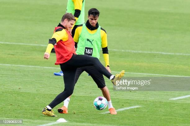 Lukasz Piszczek of Borussia Dortmund and Reinier of Borussia Dortmund battle for the ball during the Borussia Dortmund Training session on October 13...