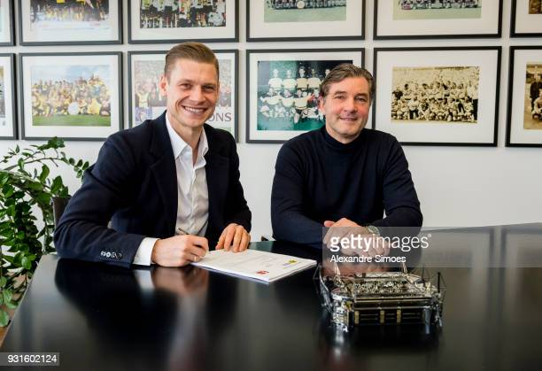 Lukasz Piszczek of Borussia Dortmund attends his contract extension signing for Borussia Dortmund with Michael Zorc on March 13 2018 in Dortmund...